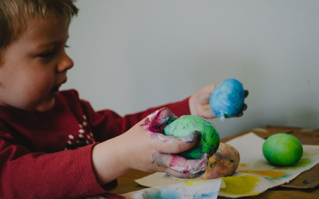Child holding Dyed Eggs